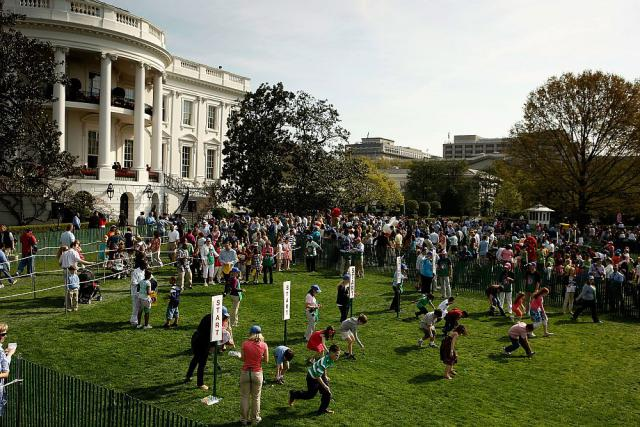 WASHINGTON - APRIL 05: Children participate in the Easter Egg Roll on the South Lawn of the White House April 5, 2010 in Washington, DC. About 30,000 people are expected to attend attended the 132-year-old tradition of rolling colored eggs down the South Lawn of the White House. (Photo by Chip Somodevilla/Getty Images)