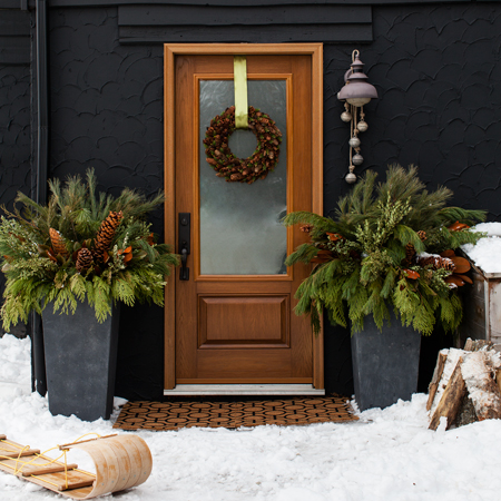 450x450-nov2013-pg107-donnagriffith-house-and-home-entryway-holiday-urns-13102_exterior1sled-2_finals_0
